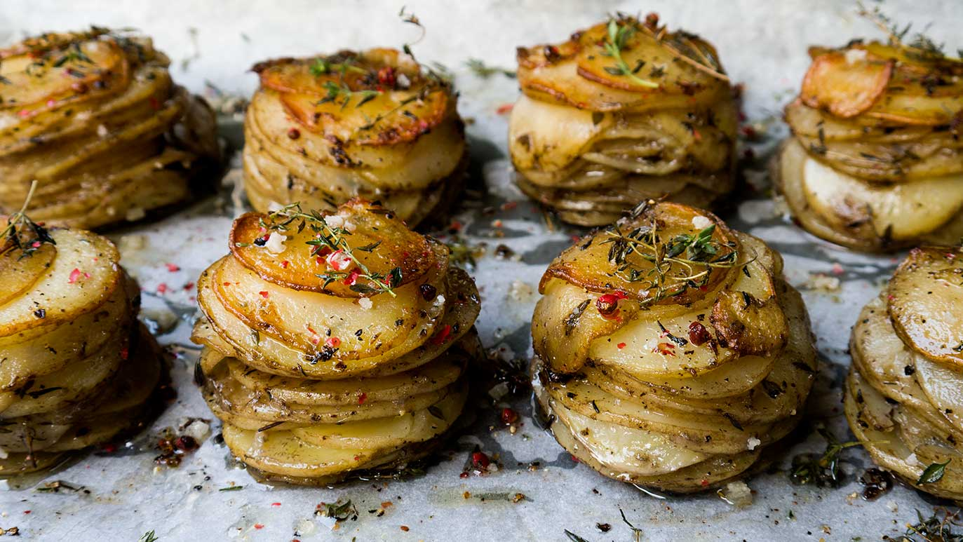 'pommes anna' potato stacks with duck fat