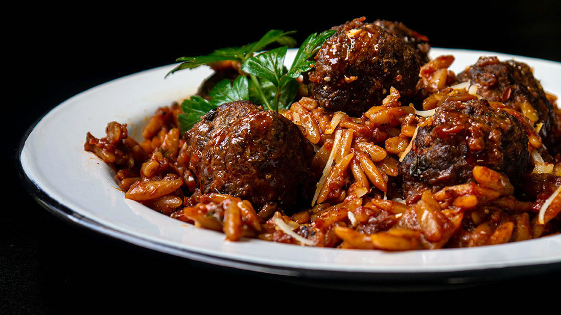 """keftedes giouvetsi"" casserole with ""kokkinisto"" meatballs & orzo pasta"