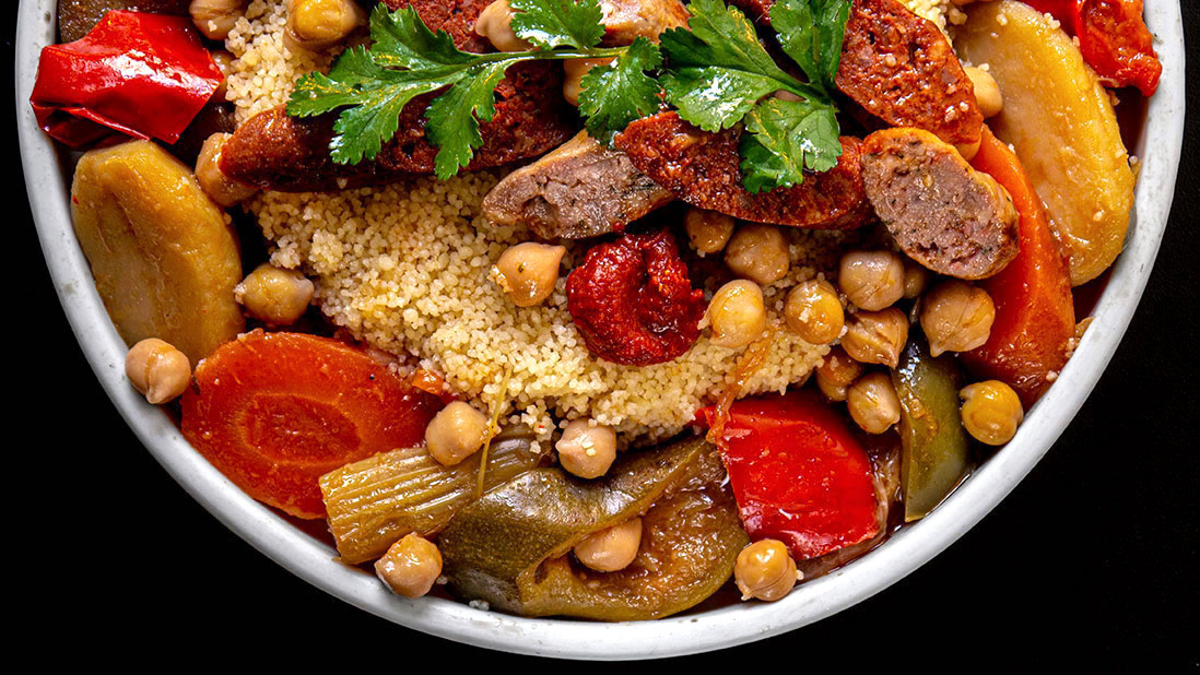 couscous with stewed vegetables & grilled sausages